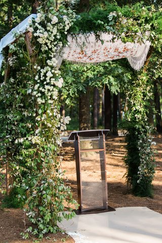 outdoor-jewish-wedding-ceremony-greenery-chuppah-with-shawl-on-top-mother-of-bride