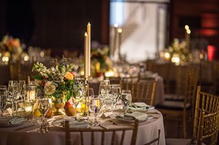 wedding-reception-table-art-museum-painting-inspired-centerpiece-flowers-fruit-taper-candles