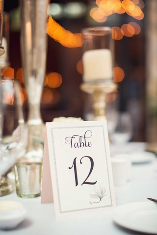 table-12-denoted-on-pale-pink-tent-table-card-for-wedding-with-flower-motif