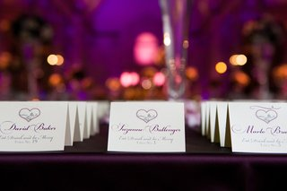 seating-cards-with-purple-lettering-and-heart