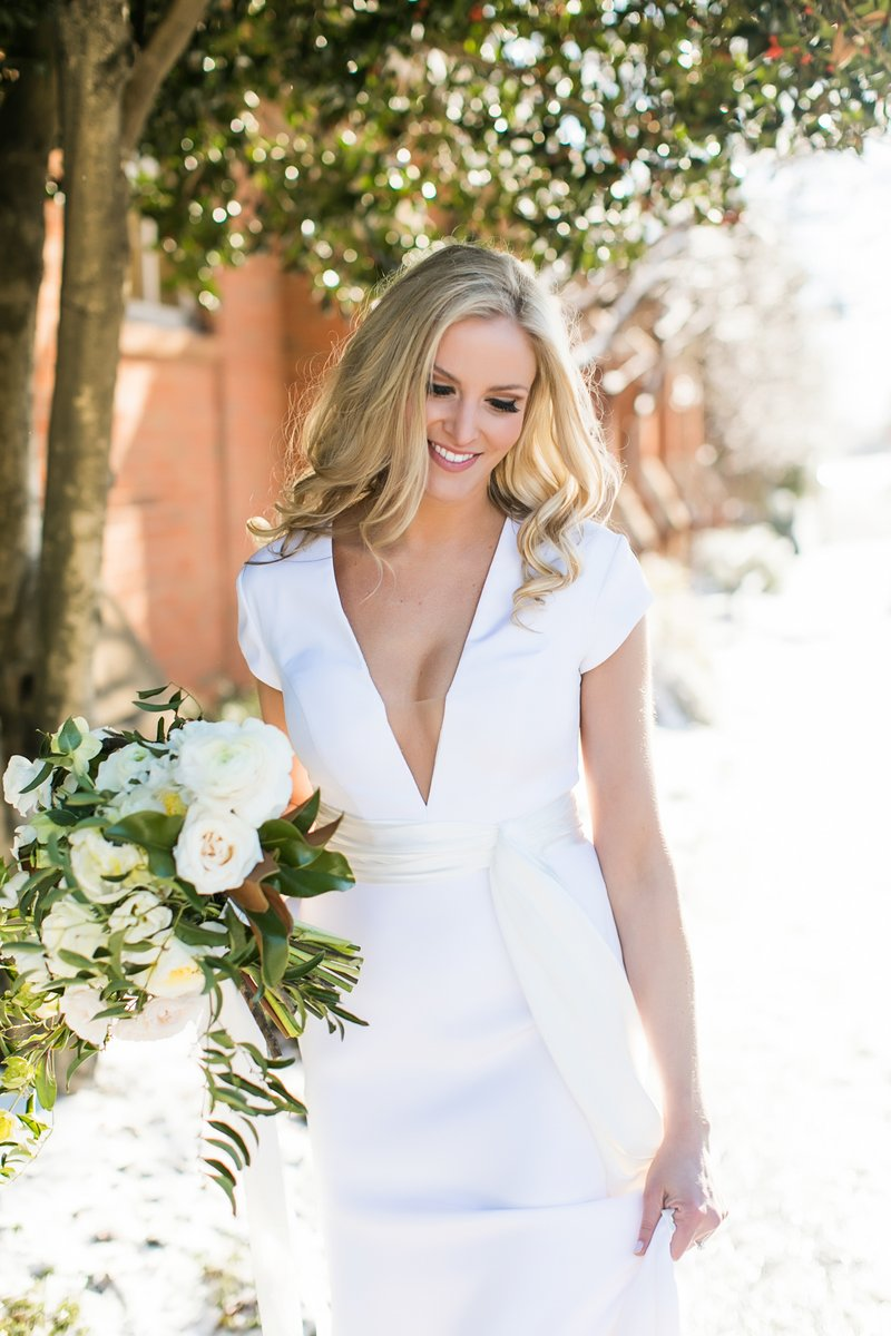 Bride Smiles in V-Neck Gown