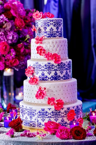 five-tier-wedding-cake-with-layers-of-blue-damask-and-ivory-pincushion-diamond-bands-pink-orchids