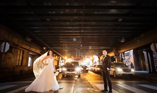 bride-in-essence-of-australia-wedding-dress-groom-in-bonobos-tux-standing-in-crosswalk-in-chicago