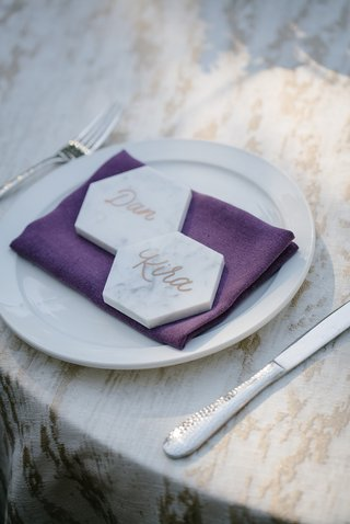 marble-hexagons-as-place-cards-with-calligraphy-on-plum-napkin