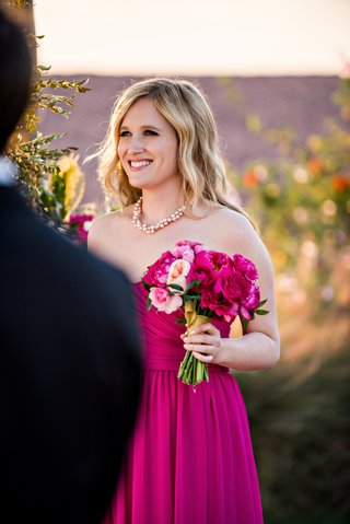 blonde-bridesmaid-in-strapless-pink-dress-with-peony-and-rose-bouquet