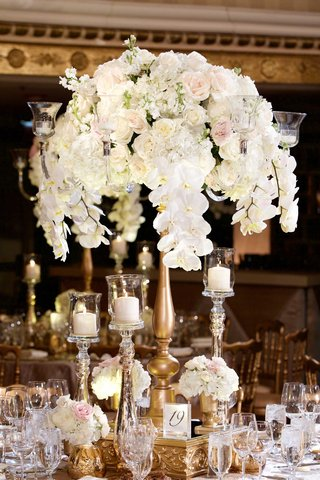 orchid-hydrangea-ranunculus-wedding-flower-arrangement-on-gold-stand-mercury-glass-candle-holders