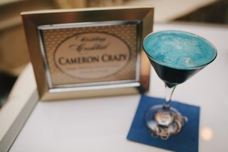 signature-blue-wedding-cocktail-in-martini-glass