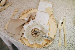 fall-wedding-ideas-inspiration-gold-pumpkin-on-gold-plate-with-gold-flatware-menu-card
