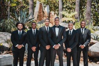 groom-in-custom-tuxedo-and-textured-jacket-groomsmen-in-three-piece-suits