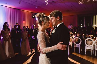bride-in-monique-lhuillier-groom-in-jos-a-bank-hold-each-other-during-first-dance