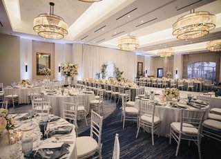 wedding-reception-hotel-ballroom-blue-carpet-grey-blue-color-palette-white-flowers