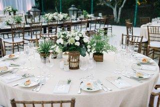 round-tablescape-green-white-details-gold-baskets-centerpieces-beach-wedding-reception-oceanside-ca