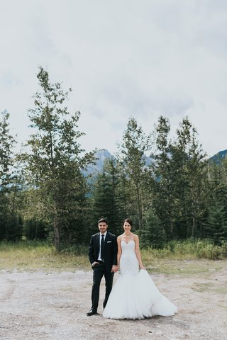 groom-in-ermenegildo-zegna-bride-in-watters-banff-national-park