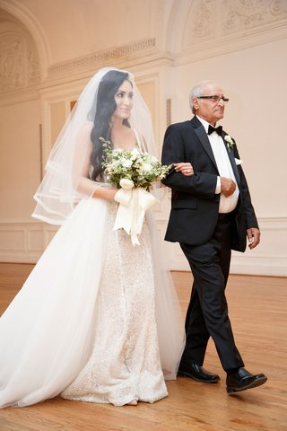 wedding-ceremony-processional-bride-with-father-arm-in-arm-overskirt-sparkle-gown-veil-long-hair