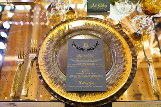gold-forks-and-knife-gold-charger-plate-grey-menu-card-with-laser-cut-antler-details-and-gold-letter