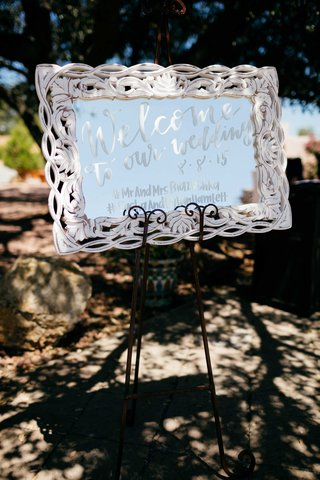 welcome-sign-mirrored-sign-double-wedding-in-malibu-white-calligraphy-white-mirror-frame