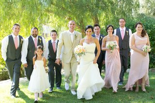 bride-and-groom-walking-with-bridesmaids-and-groomsmen