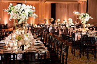 reception-decor-black-chairs-mirrored-tables-floral-centerpieces-white-flowers-candlelight