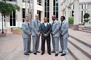 groom-in-three-piece-suit-with-diverse-groomsmen