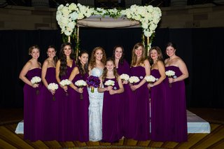 bridesmaids-and-junior-bridesmaids-in-long-bridesmaid-dresses-in-deep-purple-color