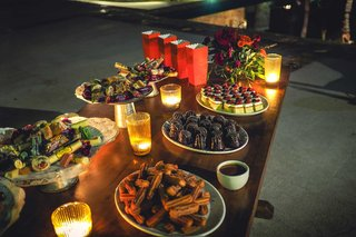 a-delicious-dessert-table-with-small-votive-candles-including-mexican-cookies-and-candies