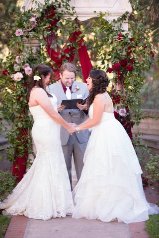 same-sex-wedding-two-brides-winnie-couture-gown-hayley-paige-gown-laughing-during-ceremony