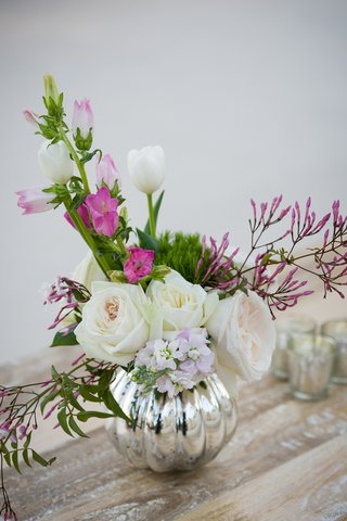mercury-glass-vessel-filled-with-delicate-flowers