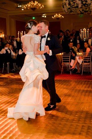 wedding-reception-bride-keyhole-back-wedding-dress-groom-first-dance-chandelier-dance-floo