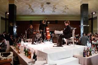 wedding-cocktail-hour-with-cello-player-drummer-and-keyboardist-behind-bar-the-standard-club