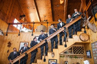 seven-groomsmen-and-groom-on-rustic-staircase-at-villa