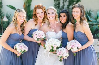bride-in-oscar-de-la-renta-strapless-wedding-dress-with-bridesmaids-in-strapless-purple-dresses