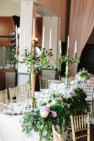 tall-gold-candelabrum-centerpieces-with-green-ivy-and-pink-white-flowers-with-greenery