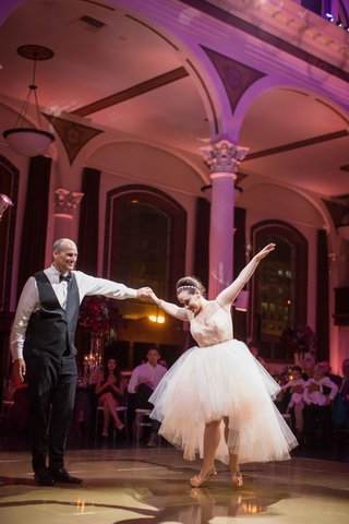 bride-performing-father-daughter-dance-in-high-heels-with-high-low-skirt-for-reception-dress