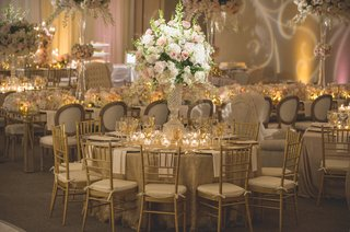 wedding-reception-table-with-gold-sequined-linen-cut-crystal-vase-with-white-hydrangeas-orchids
