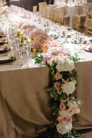 a-cascading-floral-table-runner-featuring-foliages-and-white-pink-and-orange-flowers