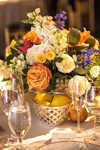 wedding-reception-low-centerpiece-with-basket-filled-with-lemon-pears-orange-and-yellow-flowers