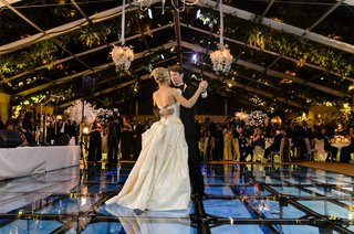 bride-and-groom-dance-on-glass-covered-pool
