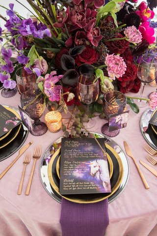wedding-styled-shoot-blush-purple-napkins-unicorn-menu-card-red-purple-pink-centerpiece-flowers