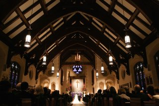 illinois-church-wedding-ceremony-with-red-and-green-flowers-at-altar