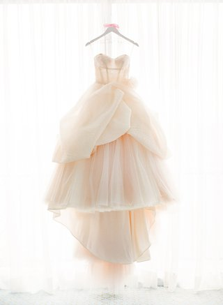 strapless-wedding-dress-with-tiered-peplum-skirt