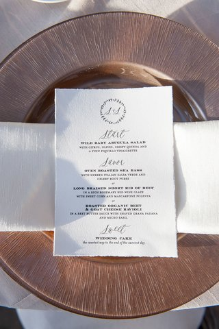 wedding-menu-with-torn-edges-monogram-at-top-calligraphy-and-menu-selections