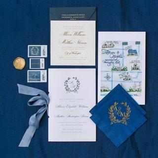 wedding-invitation-with-laurel-wreath-monogram-painted-map-napkins-gold-monogram