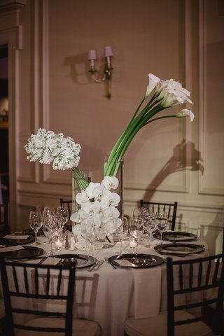 modern-wedding-centerpieces-with-white-calla-lilies-orchids-and-stock-flowers