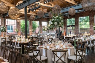 the-foundry-at-puritan-mill-wedding-brick-reception-space-vineyard-chairs-rustic-light-fixtures