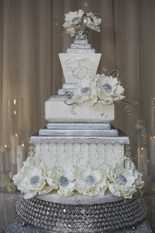 white-and-silver-wedding-cake-with-sugar-flowers-and-crystals