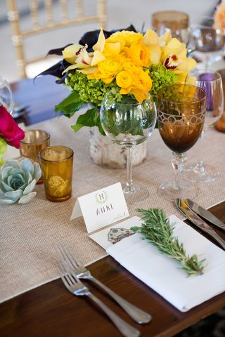 rosemary-amber-cups-rustic-reception-colored-glassware-yellow-centerpiece
