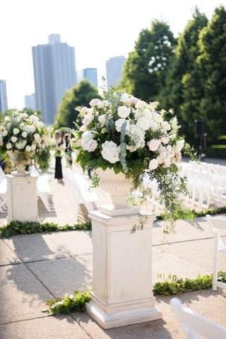 outdoor-wedding-ceremony-white-risers-and-urns-field-museum-ceremony-white-greenery-arrangements