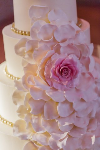 cake-adorned-with-cascading-pink-sugar-flower