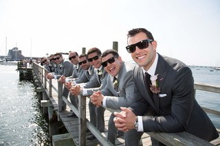 john-colaneri-co-host-of-kitchen-cousins-in-a-dark-grey-suit-and-his-groomsmen-at-pier