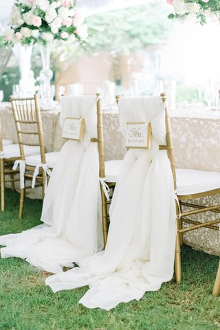 couple-chair-signage-flowing-fabric-gold-ivory-south-carolina-tented-wedding-reception-royal-regal